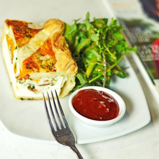 Bacon and egg pie with salad greens