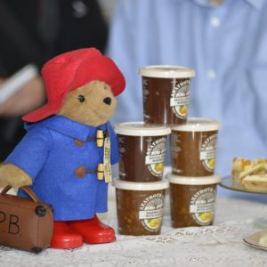 Paddington Bear with an assortment of jams